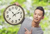 Adam tutarak saati — Stok fotoğraf