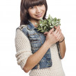 Woman holding plant — Stock Photo #47476233