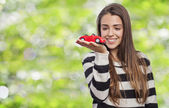 Woman holding car — Stock Photo