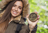 Woman holding compass — Stock Photo
