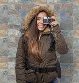 Kobieta przy fotografia — Zdjęcie stockowe