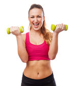Woman holding weights — Stock Photo