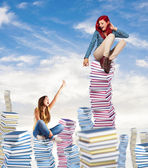 Women on books — ストック写真