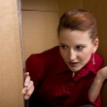 Businesswoman in cardboard box — Stock Photo