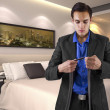 Businessman getting dressed in a hotel — Stock Photo #49304789