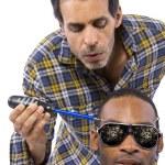 Mechanic or handyman fixing loose screws on male head — Stock Photo #49308123