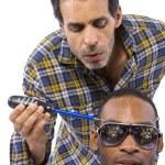 Mechanic or handyman fixing loose screws on male head — Stock Photo #49308145