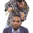 Mechanic or handyman fixing loose screws on male head — Stock Photo