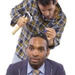 Mechanic or handyman fixing loose screws on male head — Stock Photo #49308165