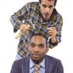 Mechanic or handyman fixing loose screws on male head — Stock Photo #49308167