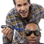 Mechanic or handyman fixing loose screws on male head — Stock Photo #49308193