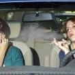 Woman smoking while driving inside the car — Stock Photo #49309025