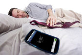 Man in bed with Alarm clock — Stock Photo