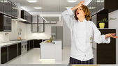 Stressed female chef in kitchen — Stock Photo