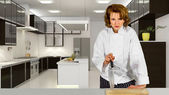 Female chef in commercial kitchen — Stock Photo