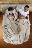 Woman with boyfriend in bed — Stockfoto