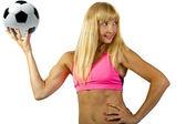 Female soccer posing with ball — Stockfoto