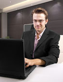 Caucasian male using laptop — Photo