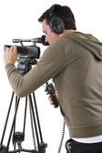 Camera operator with tripod — Stock Photo