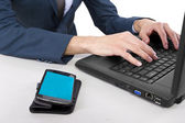 Cellphone on desk with blank screen for composites — Stockfoto