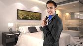 Businessman getting dressed in a hotel — ストック写真