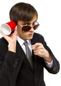 American spy holding a cup — Stock Photo