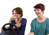 Woman eating a sandwich while driving — Stock Photo