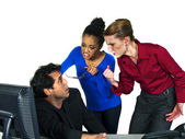 Female employees blaming male co worker — Stock Photo