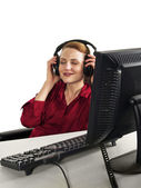 Business woman listening to music on headphones — Foto Stock