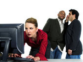 Male co workers gossiping bout female co worker — Stock Photo