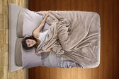 Woman in bed unable to sleep — Stock Photo