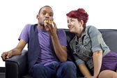Male refusing to share food with female roomate — Stock Photo