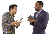 Businessman paying hired blue collar laborer for services — Stock Photo