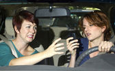 Passenger frightened by reckless driver holding a cell phone — Stock Photo