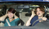 Passenger and singing female driver — Stock Photo