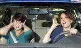 Passenger and singing female driver — Stock Photo