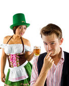 Woman in St Patty's costume serving customers — Stock Photo