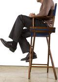 Sitting Hollywood producer — Stock Photo