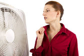 Businesswoman cooling off with a fan — Stock Photo
