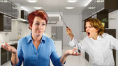 Chef and waitress fighting in the kitchen — Stock Photo