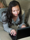 Girl browsing with a laptop — Stock Photo