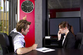 Male boss angry at late female employee — Stock Photo