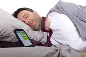 Man sleeping and receiving text messages from work — Stock Photo