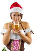 Female bartender holding glass of beer — Stock Photo