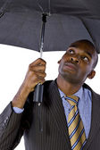 Uomo d'affari sotto un ombrello — Foto Stock
