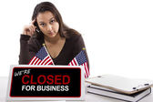Woman with desk sign — Stock Photo