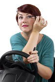 Woman applying make up while driving — Stock Photo