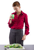 Woman grossed out by vegetable juice — Stock Photo