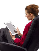 Woman looking at tablet computer — Stock Photo