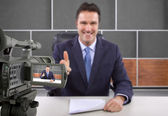 Camera recording male reporter — Stock Photo